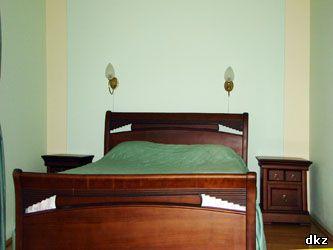 Интерьер спальни номера люкс повышеного комфорта